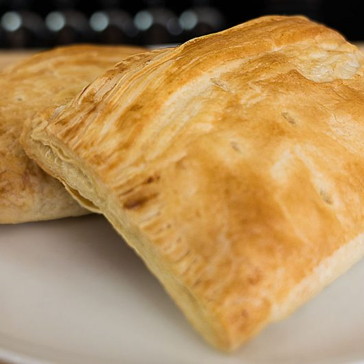 A picture of 2 cheese and onion pasties